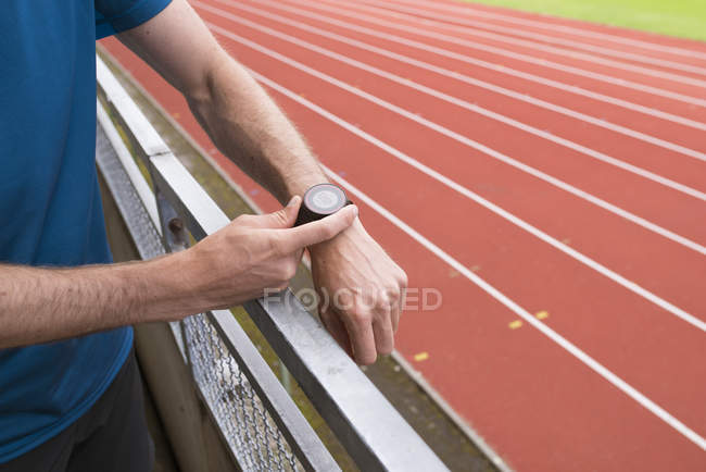 Athlete preparing for training, selective focus — Stock Photo