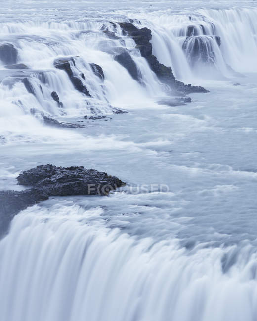 Flow of Gullfoss waterfall with steam on Hvita river in Iceland — Stock Photo