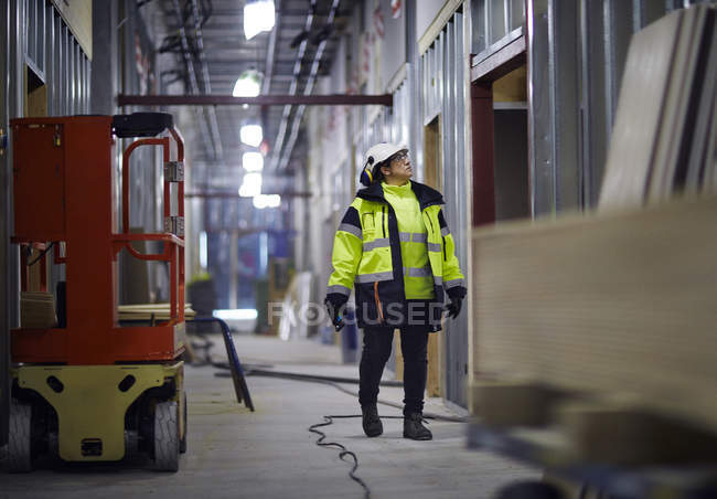 Woman in protective clothing looking away — Stock Photo