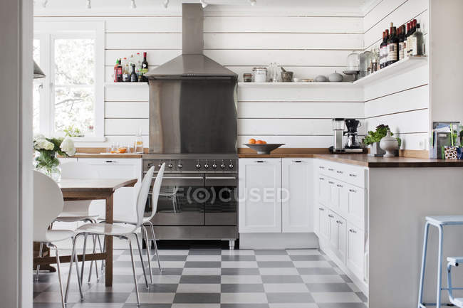 Domestic kitchen with white furniture, house interior — Stock Photo