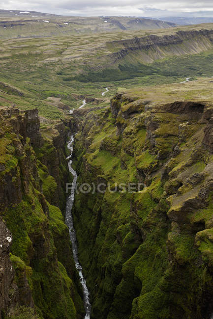 Glymur waterfall with green cliffs in Iceland — Stock Photo