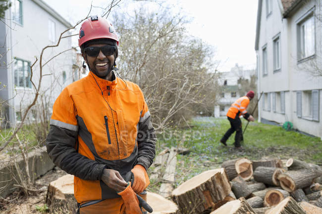 Arborists in protective workwear working, focus on foreground — Stock Photo