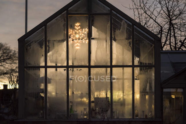 Facade of modern glass house with Christmas decorations — Stock Photo