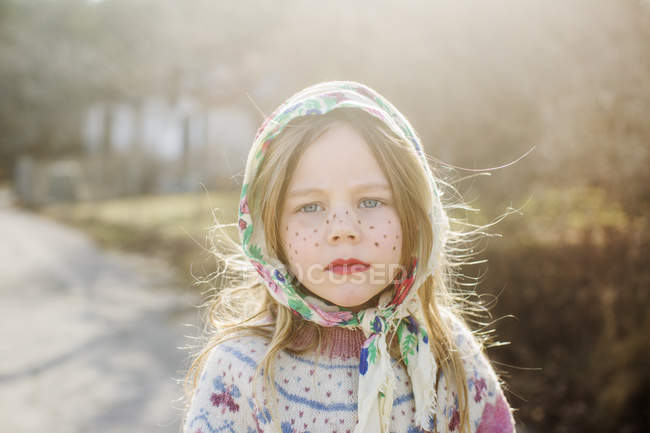Portrait of girl dressed up as Easter witch wearing headscarf — Stock Photo