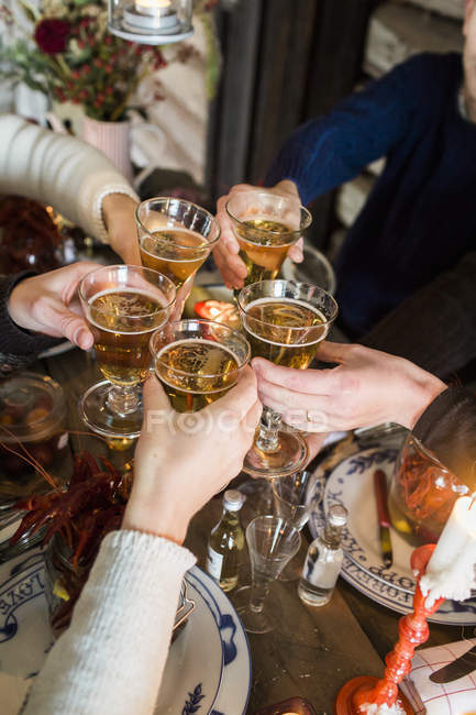 People raising toast during crayfish party — Stock Photo