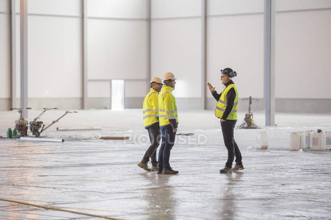 Three engineers at work, selective focus - foto de stock
