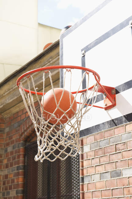 Close up shot of basketball hoop with falling ball — Stock Photo