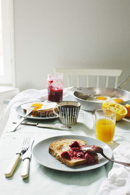 Breakfast on table, house interior, selective focus — Stock Photo
