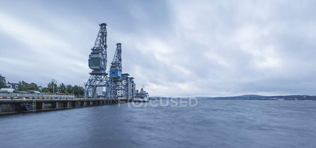 Commercial docks by sea, northern europe — Stock Photo