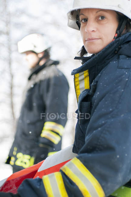 Firefighters wearing protective workwear in winter — Stock Photo