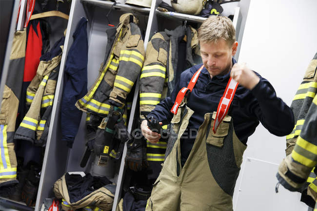 Front view of fireman in protective workwear — Stock Photo