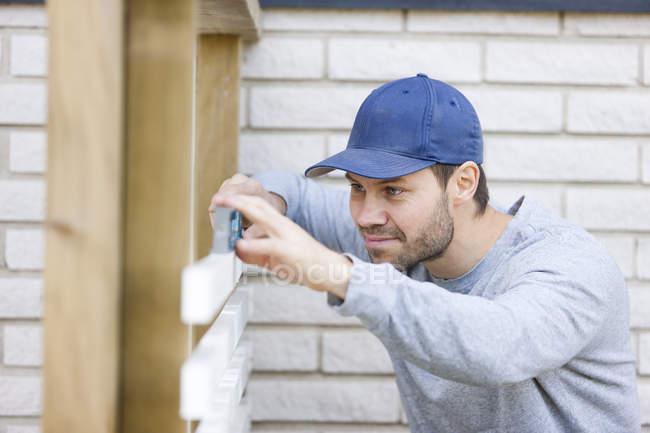 Man using level tool, selective focus — Stock Photo