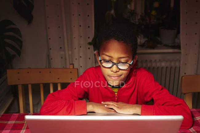 Boy using laptop, selective focus — Stock Photo