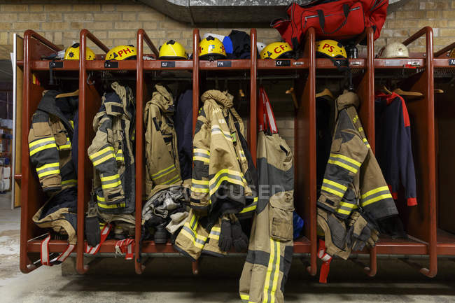 Front view of protective clothing at fire station — Stock Photo
