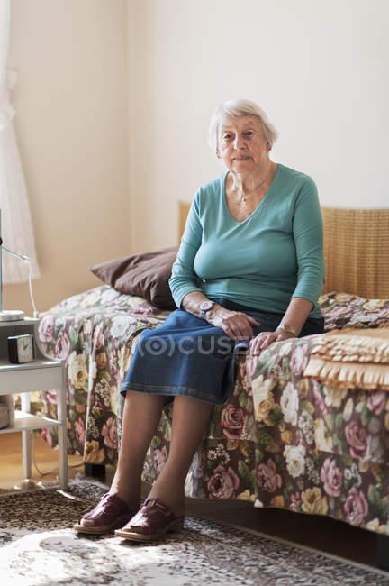 Portrait of senior woman looking at camera — Stock Photo