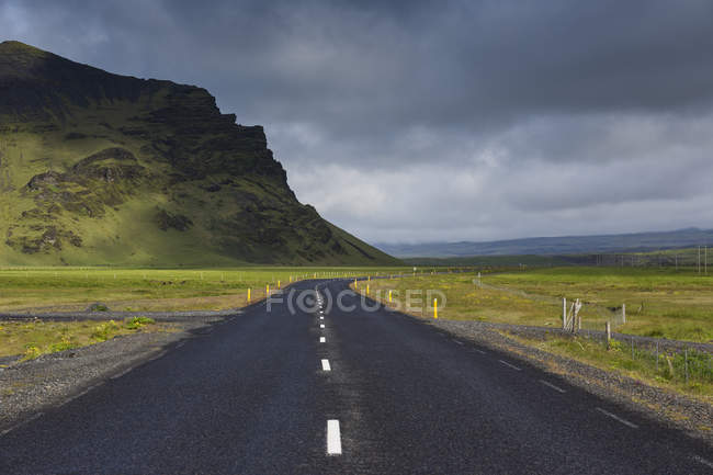 Rural road under storm clouds in Iceland — Stock Photo