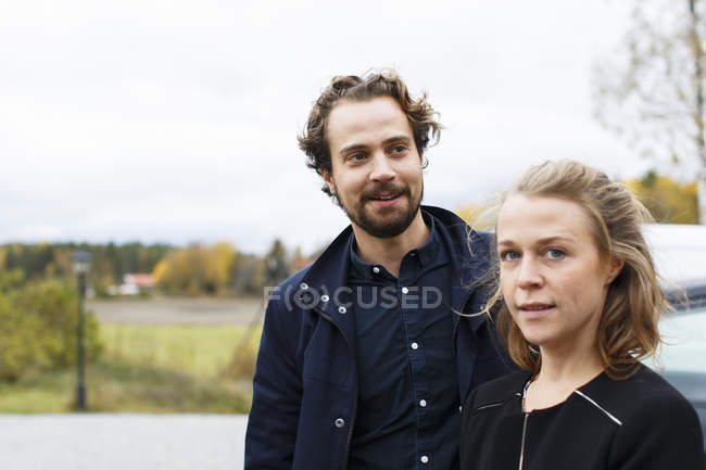 Portrait of mid-adult man and woman, selective focus — Stock Photo