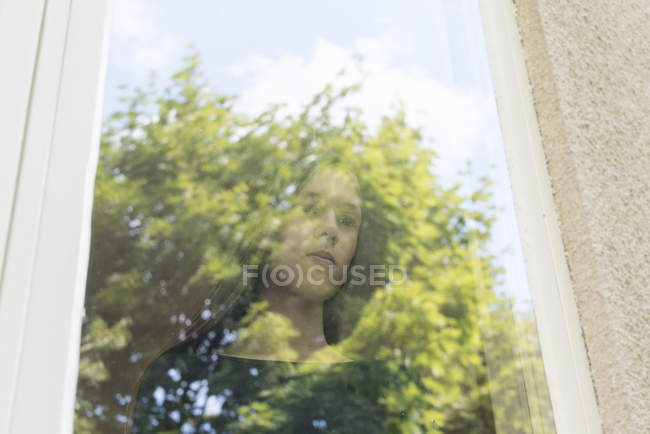 Girl looking out window, selective focus — Stock Photo