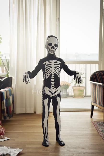 Boy dressed up as skeleton at Halloween — Foto stock