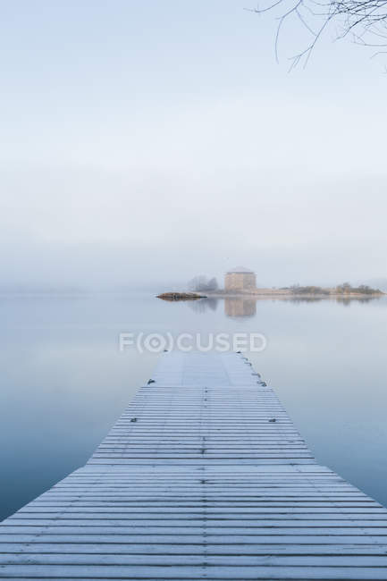 Scenic view of wooden pier and sea — Stock Photo