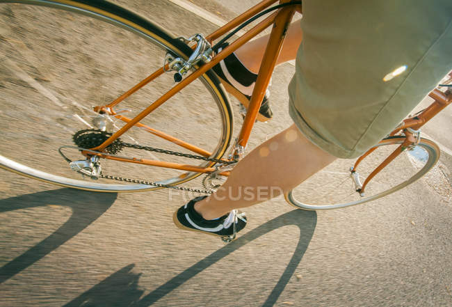 Cropped view of man cycling, selective focus — Photo de stock