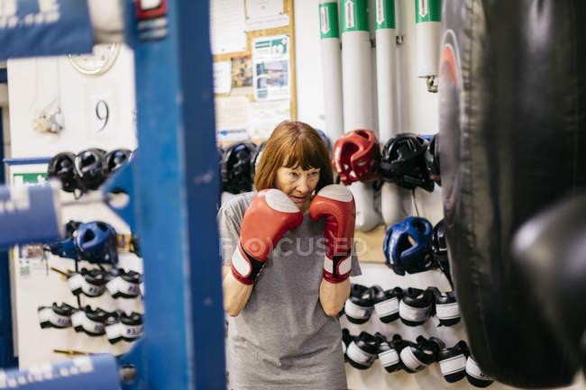 Senior woman at boxing training, selective focus — Stock Photo