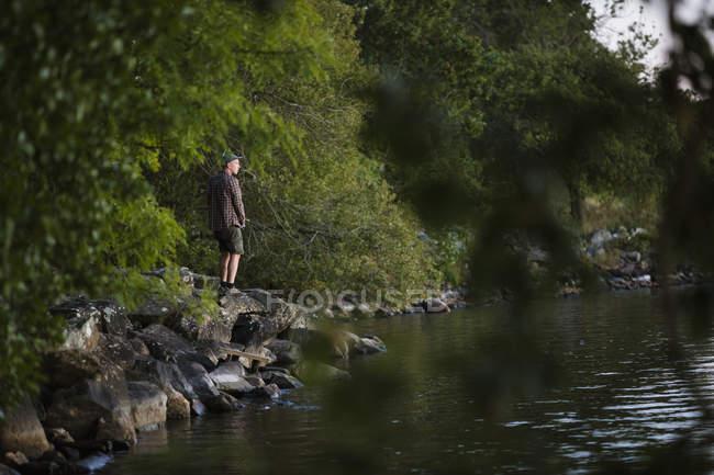 Mid adult man fishing, selective focus — Stock Photo