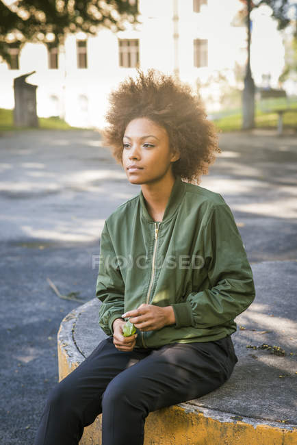 Young woman daydreaming, focus on foreground — Stock Photo