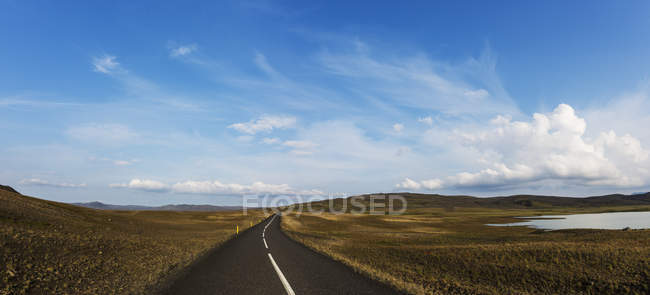 Scenic view of rural road and field, scandinavia — Stock Photo
