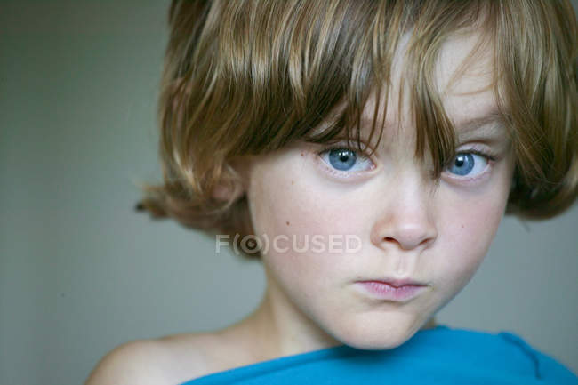 Portrait of boy with blue eyes, soft focus background — Stock Photo