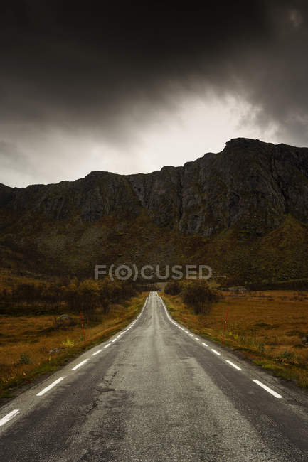 Rural road under storm clouds in Sweden — Stock Photo