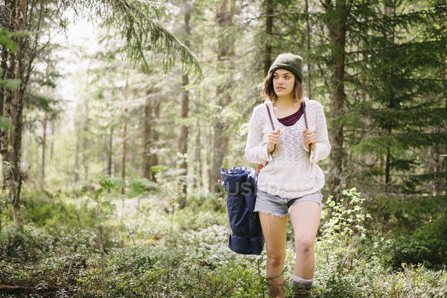 Young female hiker looking away in forest — Stock Photo