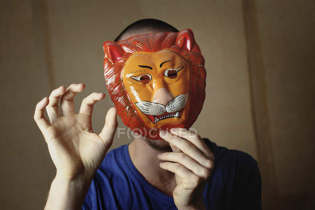 Portrait of man with animal mask, focus on foreground — Stock Photo
