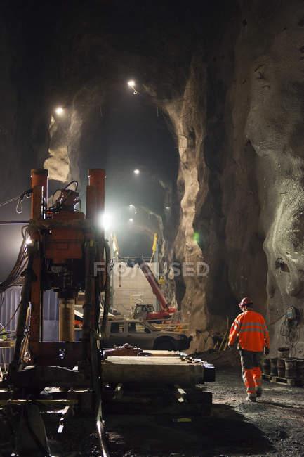 Rear view of miner working underground — Stock Photo