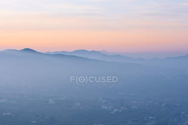 Landscape with hills in fog at dawn — Stock Photo