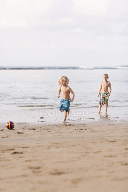 Boys playing with ball on beach, selective focus — Stock Photo