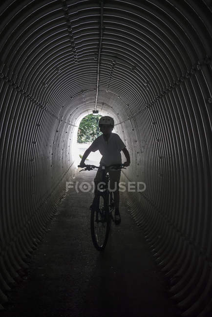 Portrait of boy on bicycle at tunnel — Foto stock