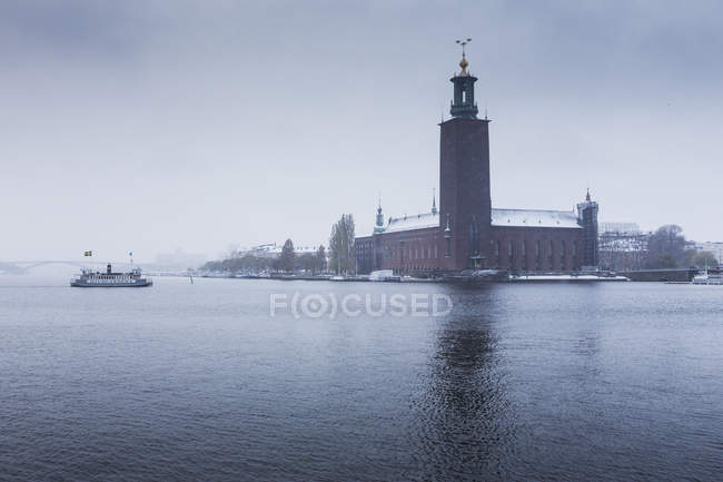 Scenic view of Stockholm City Hall under overcast sky — Stock Photo