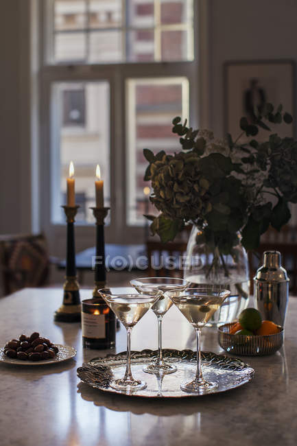 Martini drinks on table, focus on foreground — Stock Photo