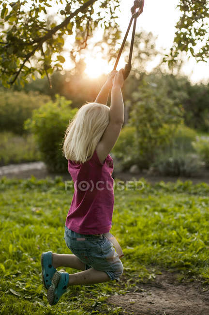 Side view of girl swinging, selective focus — Stock Photo