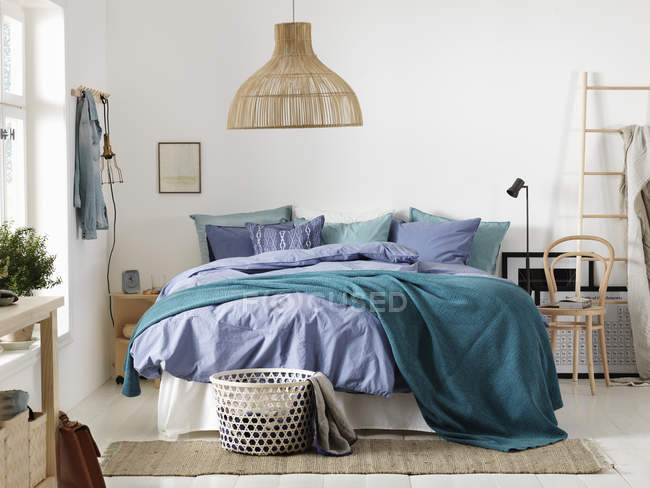 Bedroom with large bed, house interior — Stock Photo