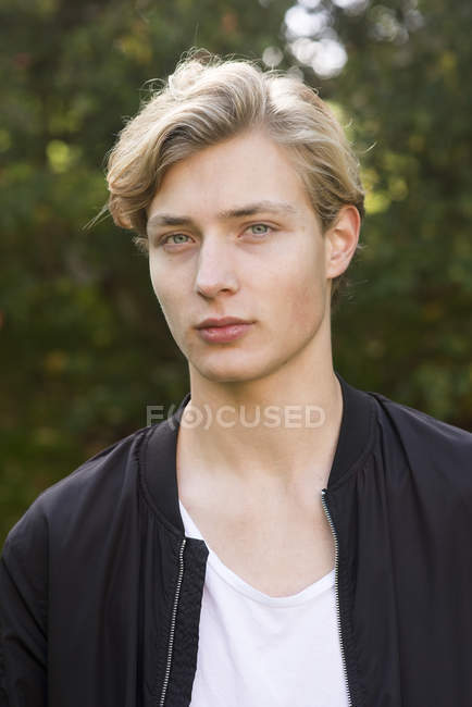 Portrait of young man, focus on foreground — Stock Photo