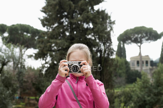 Young girl photographing, focus on foreground — Stock Photo