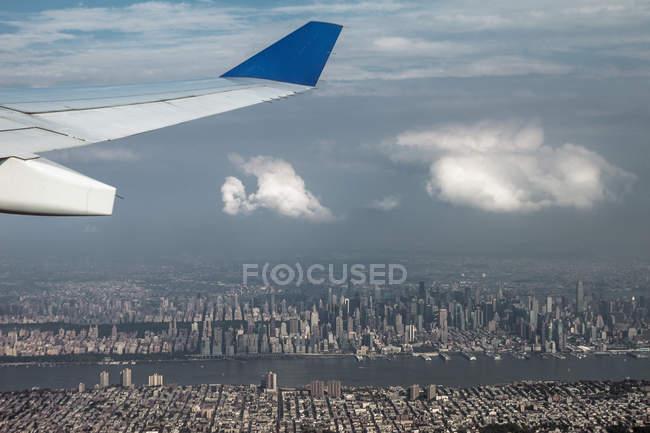 Scenic view of plane above city, selective focus — Stock Photo