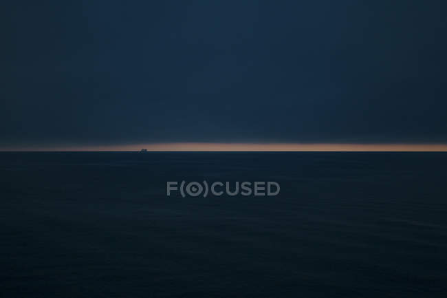 Scenic view of ship in sea at night, selective focus — Stock Photo