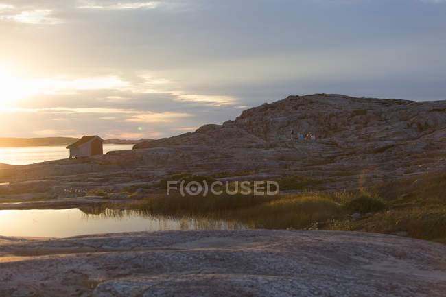 Scenic view of river near rocky mountains at sunset — Stock Photo
