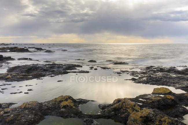 Rock formation under overcast sky in Digerhuvud, Sweden — Stock Photo