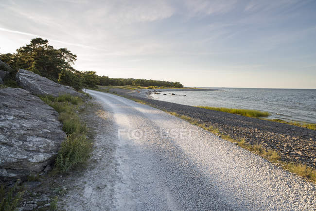 Scenic view of dirty road along beach — Stock Photo