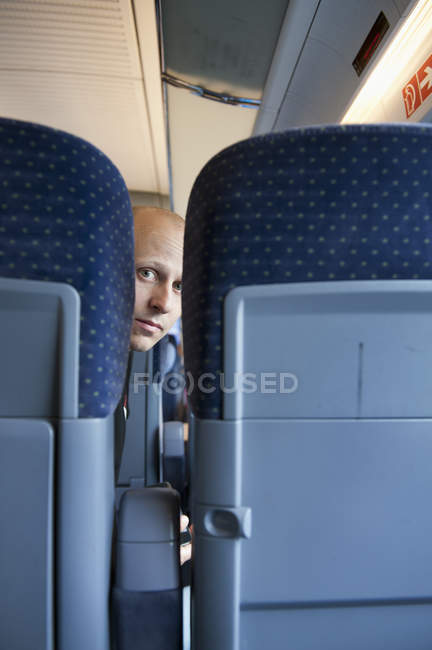 Mid adult man on train, differential focus — Stock Photo
