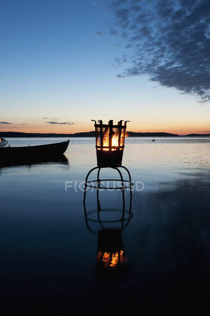 Brazier on lake at sunset, stockholm archipelago — Stock Photo